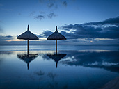 Mauritius, La Preneuse, two sunshades at swimming pool in front of the sea - DIS000698