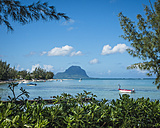 Mauritius, La Preneuse, view to Indian Ocean with fishing boat and Le Morne Brabant in the background - DIS000696