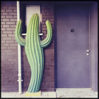 Cactus figure in front of a doorway, Munich, Bavaria, Germany - GS000869