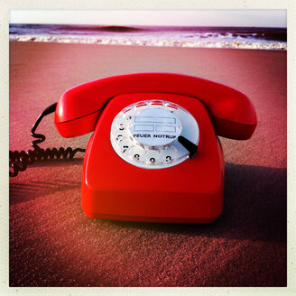 Retro phone at the beach Norderney, Germany - JAWF000021