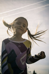 Portrait of little girl playing with Moon Hopper - SARF000427
