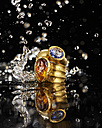 Golden ring with tanzanite and citrine, water splashing around - AKF000364