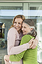 Senior mother and her daughter hugging - MFF000984