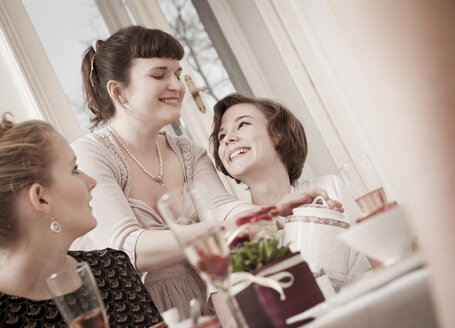 Young women on a retro style tea party - DISF000731