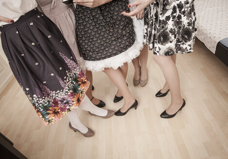 Young women in vintage dresses standing - DISF000761