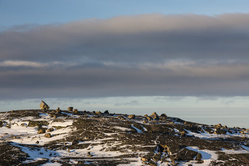 Norway, Karlebotn, Varangerfjord, Snow covered rock surface - SR000493
