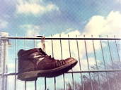 Leather boots hanging on fence, Wuppertal, Germany - DWIF000004