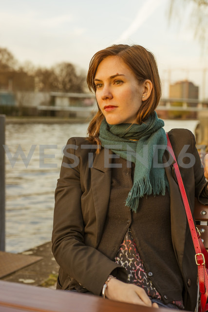 Germany, Berlin, female tourist sitting at cafe near Spree River - FBF000314 - Frank Blum/Westend61