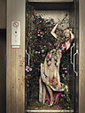 Woman in elevator with plants - CvK000091