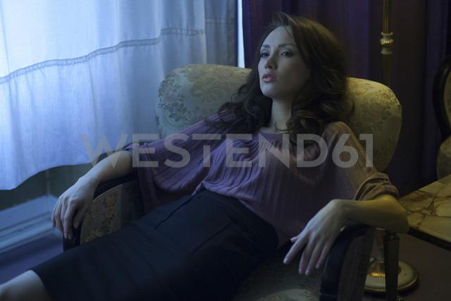 Woman sitting in armchair - CvK000103