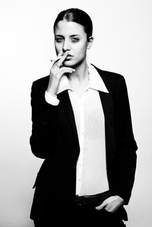 Young woman in suit smoking - CvK000144