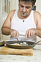 Portrait of man with bad habit sitting at breakfast table - CSBF000020