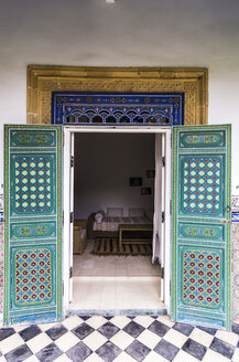 Morocco, Marrakesh-Tensift-El Haouz, painted doors and guest room of hotel - THA000221