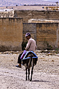 Morocco, Marrakesh-Tensift-El Haouz, Man on donkey - THA000213