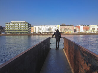 Germany, Berlin, Treptow, young man on pier - FBF000339