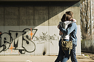 Teenage couple embracing - UUF000213