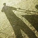 Germany, North Rhine-Westphalia, Petershagen, Shadow of a man with a lawn mower. - HAWF000083