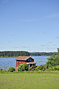 Sweden, Mora, Red hut at Lake Siljan - BR000319