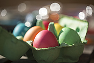 Germany, Coloful Easter eggs in cardboard box - SARF000450