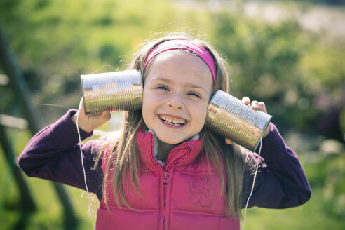 Portait of little girl with tin can phone - SARF000465