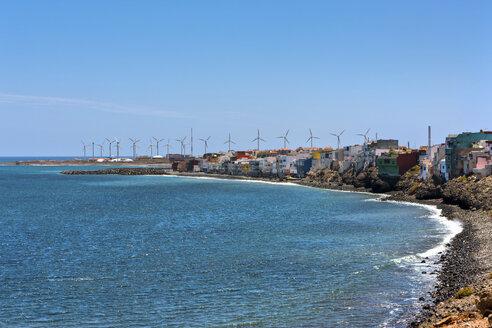 Spain, Canary Islands, Gran Canaria, Santa Lucia de Tirajana, Pozo with wind turbines - AMF002121