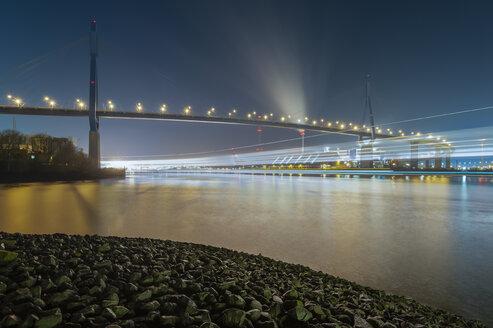 Germany, Hamburg, Port of Hamburg and Koehlbrand Bridge at night - RJ000079