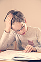 Portrait of little boy doing homework - LVF001038