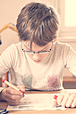 Portrait of little boy doing homework - LVF001039