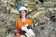 Portrait of female technician at recycling yard of aluminium - SGF000553
