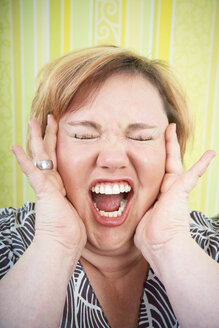 Germany, Mid-adult woman screaming - ECF000578