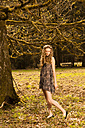 Romantic young woman standing in park - FCF000021