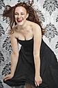 Portrait of young woman wearing little black dress - ECF000520