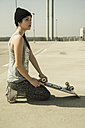 Young woman with skateboard on parking level - UUF000226