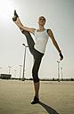 Young woman doing gymnastics outdoors - UUF000308