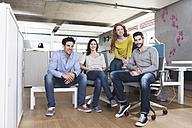 Group picture of four creative people sitting in the office - RBF001687