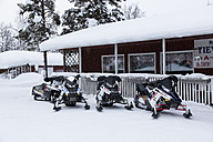 Scandinavia, Finland, Pokka, Log Cabin and snowmobiles - SR000512