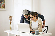 Young couple working at modern home office - EBSF000178