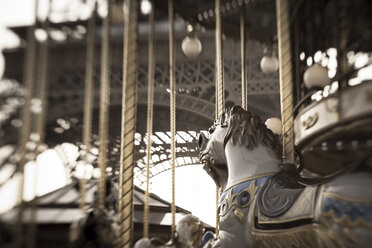 France, Paris, carousel horse in front of Eiffel Tower, partial view - FC000023