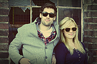 Young couple wearing sunglasses - HOHF000717