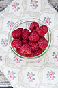 Glass of raspberries on cloth, elevated view - LVF001071