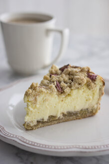 Piece of Rhubarb Cheese Cake on plate with cup of coffee - IPF000108
