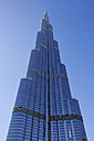 Dubai, view to Burj Khalifa in front of blue sky - RUE001245