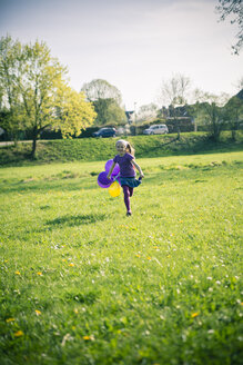Little girl with balloons running on a meadow - SARF000486