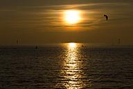 Germany, Lower Saxona, Wremen, North Sea, Kite surfer at sunset - SJF000103