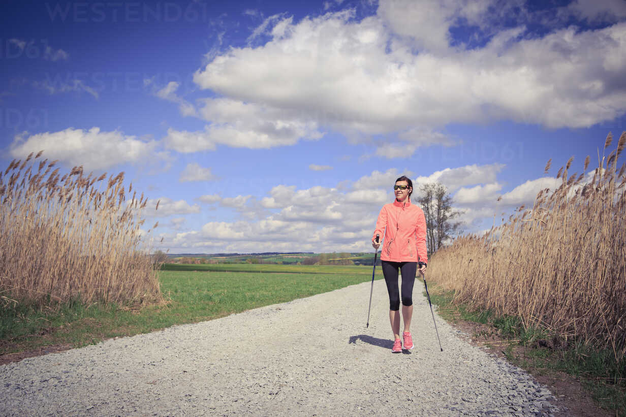 Female Nordic walker on the move through the rural landscape - VTF000214 - Val Thoermer/Westend61