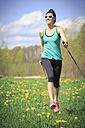 Female Nordic walker on a meadow - VTF000207