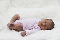 Sleeping newborn baby girl on white cloth - ROMF000011