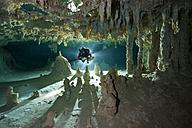 Mexico, Yucatan, Tulum, Cavern diver in a cenote - YRF000044