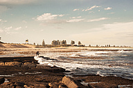 Australia, New South Wales, Tea Gardens, man at beach in the tide - FBF000366