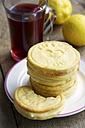 Lemon cookies with a cup rose hip tea and lemons - HAWF000118